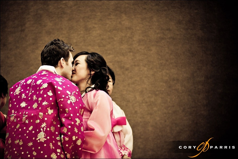 bride and groom kissing in their Korean outfits by seattle wedding photojournalist