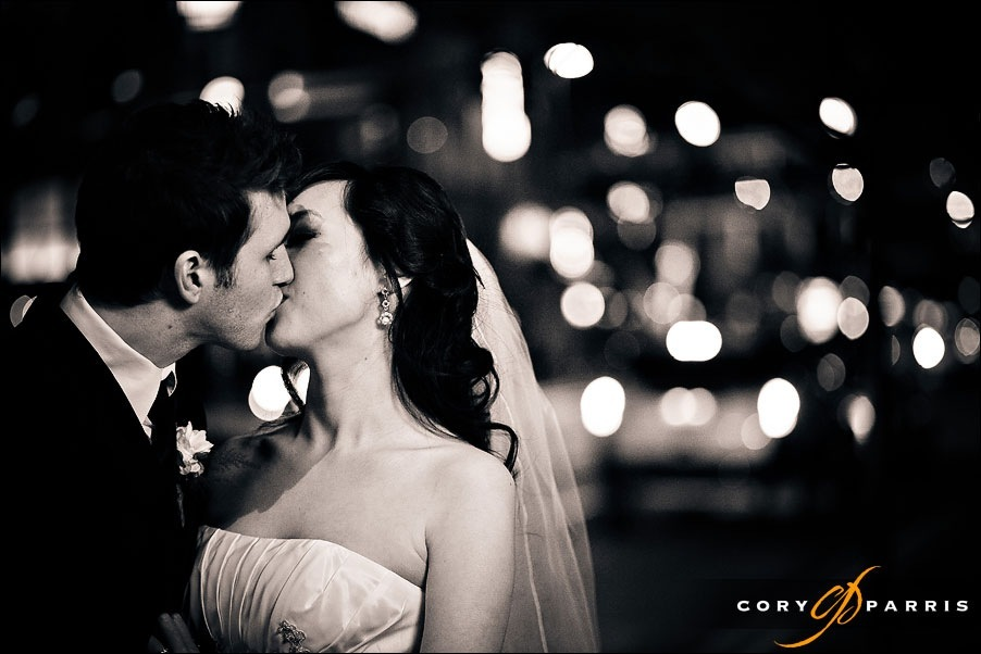 bride and groom kissing with the lights of bellevue behind them by bellevue wedding photographer cory parris