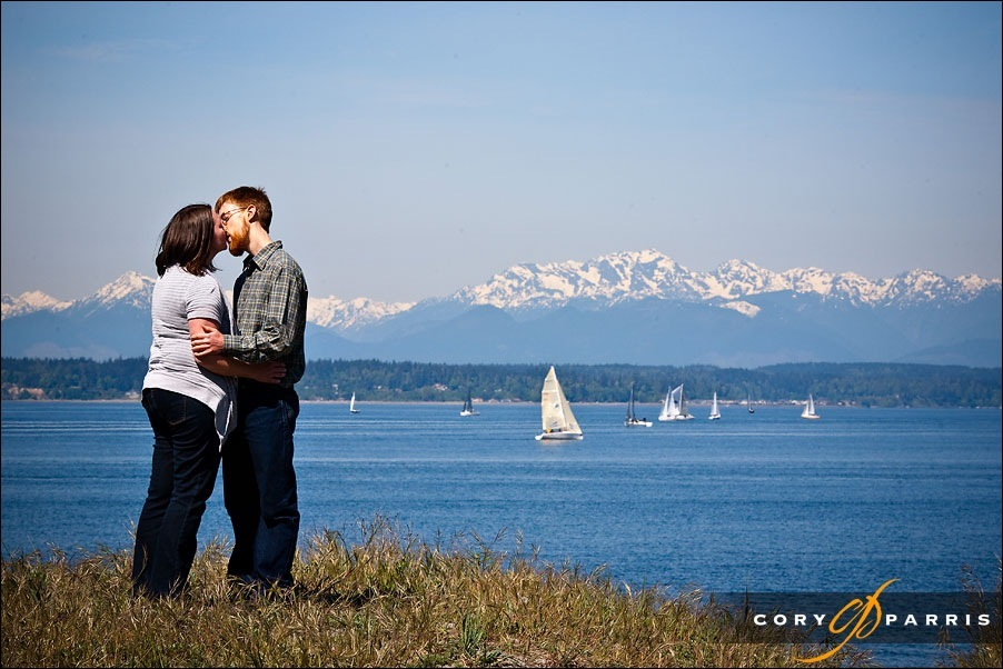 engagement portrait at the beach on golden gardens with the olympic mountains in the background