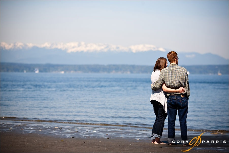 engagement portrait on the beach at golden gardens with the olympic mountains in the background by seattle wedding photographer cory parris