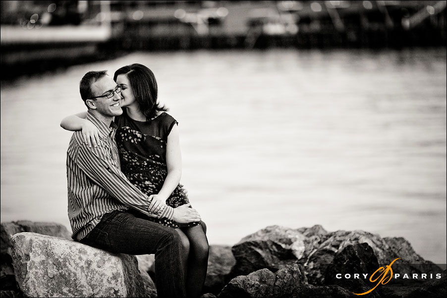 couple portrait at the seattle waterfront with the puget sound behind