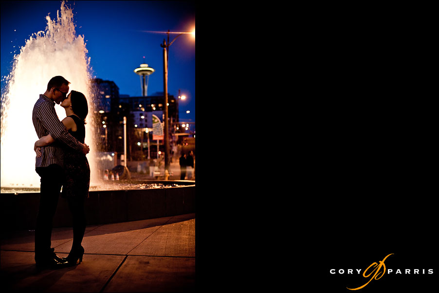 engagement portrait at night with the space needle and fountain in seattle