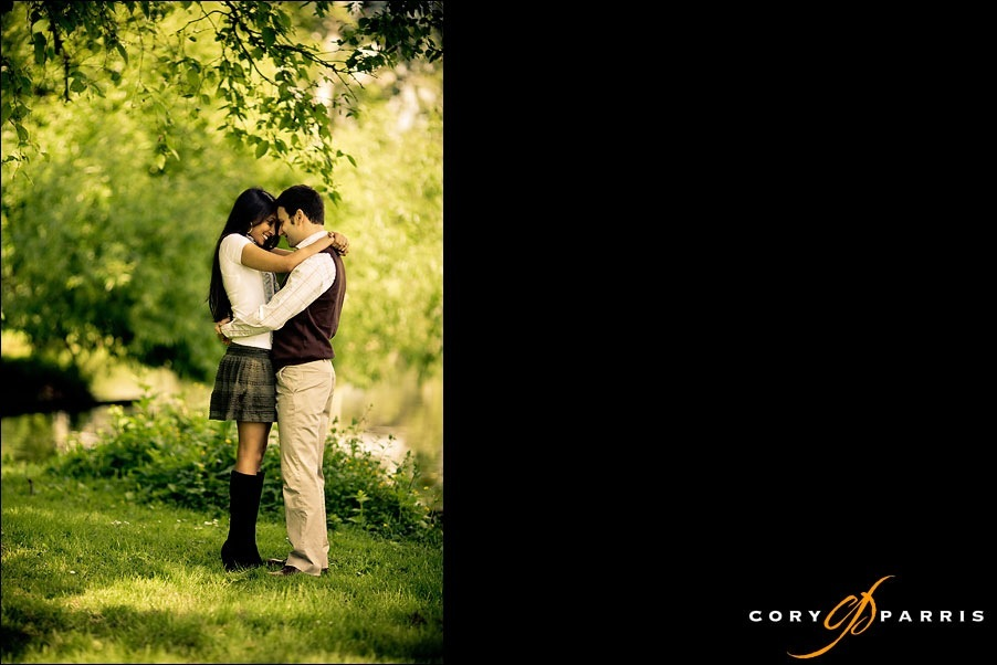 engagement portrait underneath a tree with the water in the background by seattle wedding photographer cory parris