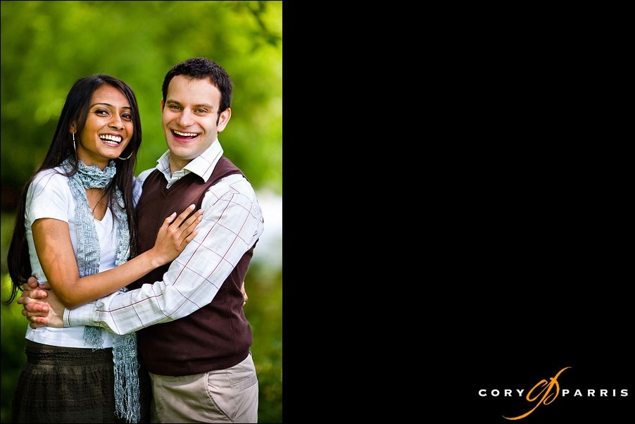 engagement portrait with laughing couple with trees in the background at washington park arboretum