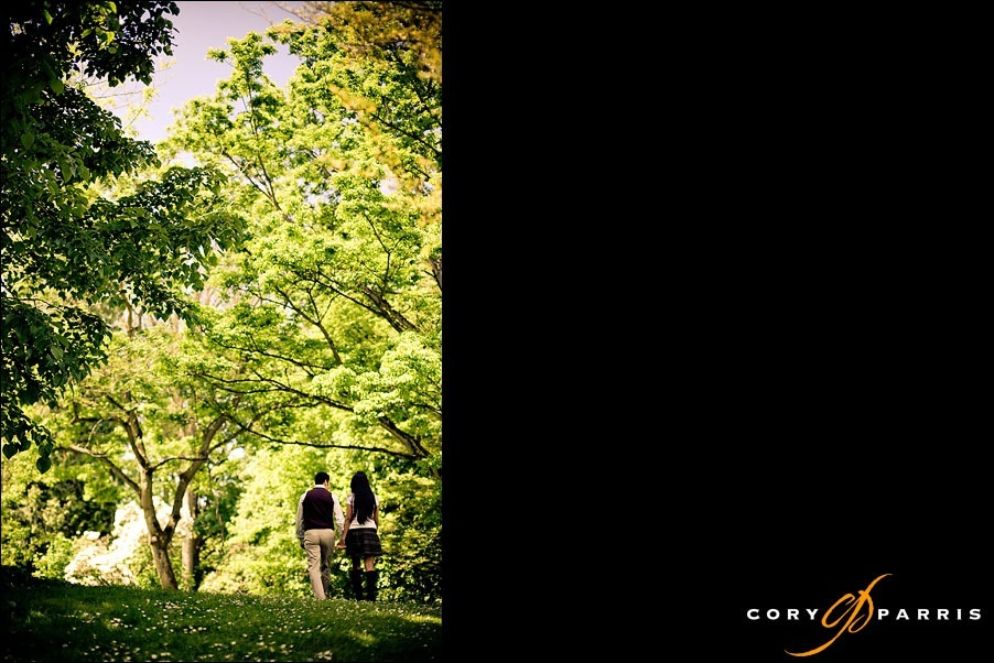 couple walking in the trees by seattle portrait photographer cory parris
