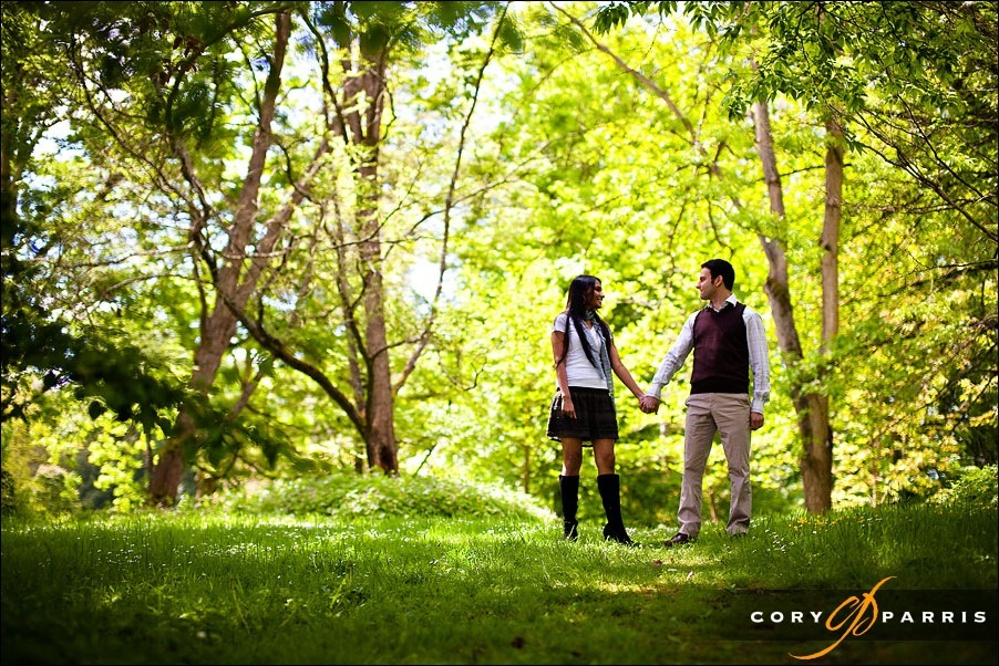 couple in the trees for engagement portraits by seattle wedding photographer cory parris