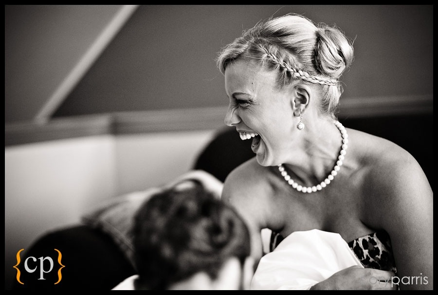 bride laughing as she gets ready for her seattle wedding