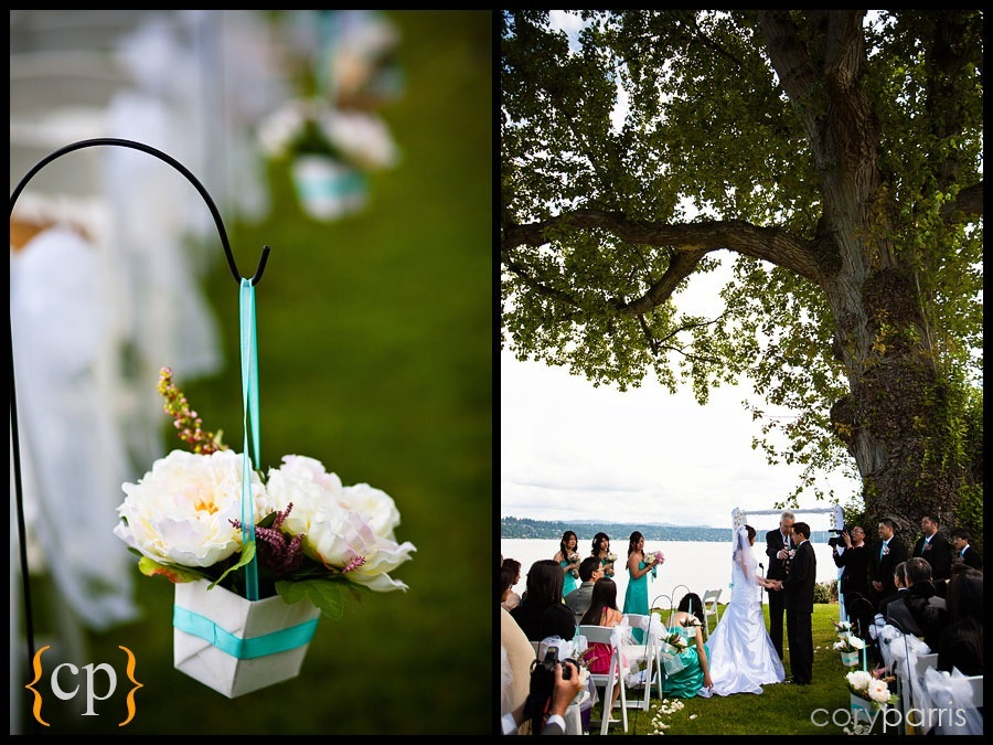 wedding flowers and a ceremony under a tree on the shores of lake washington wedding at colman park in seattle