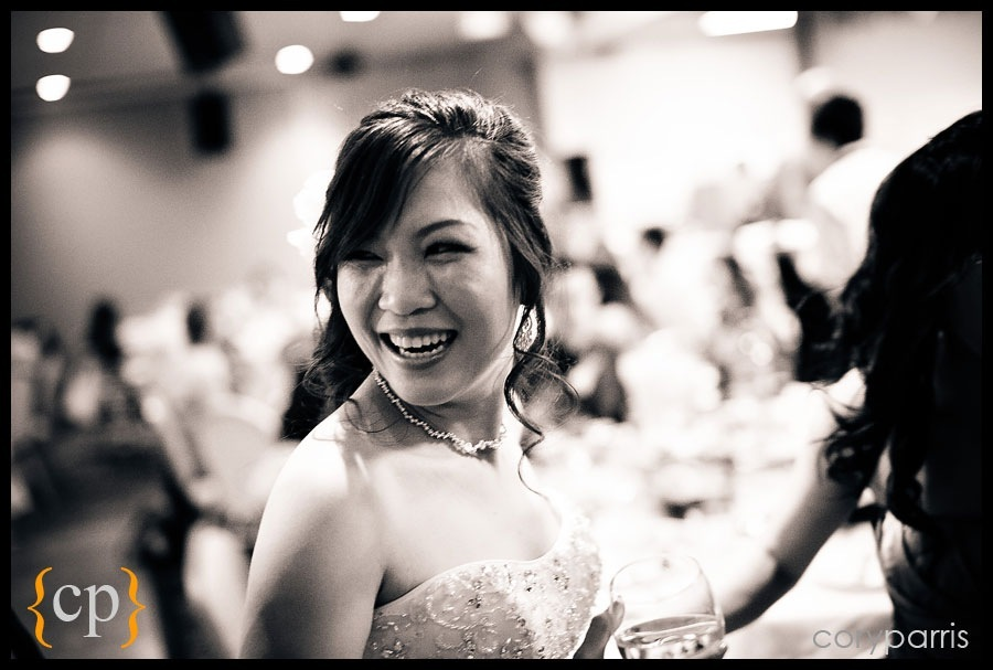 bride laughing during wedding reception by seattle photojournalist cory parris