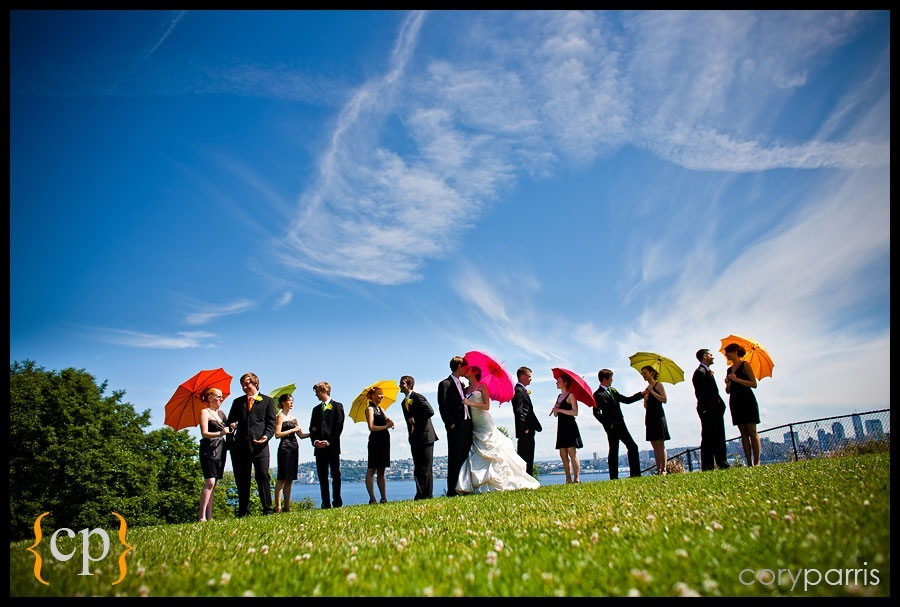 wedding party portrait at hamilton viewpoint park in seattle with bright colored umbrellas