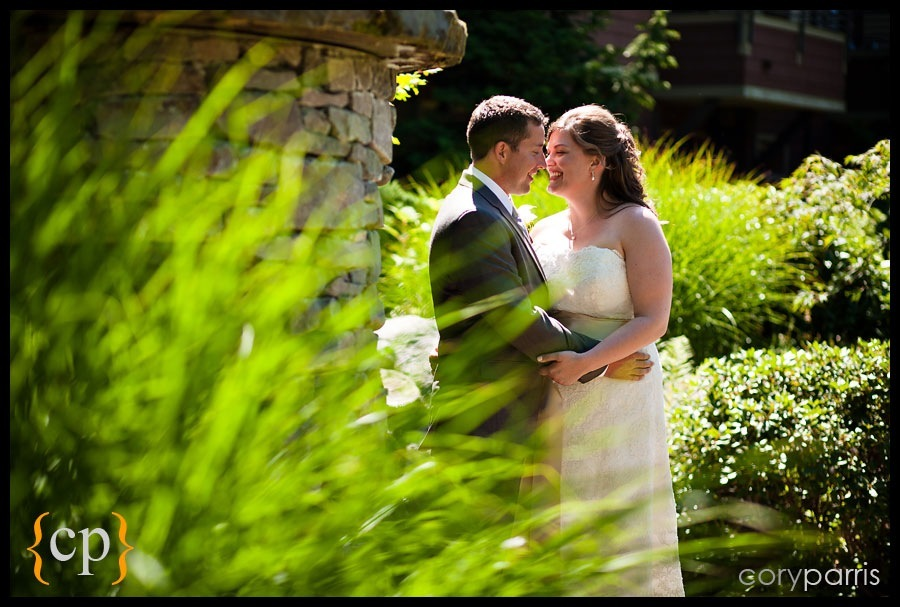bride and groom kissing by seattle wedding photographer cory parris