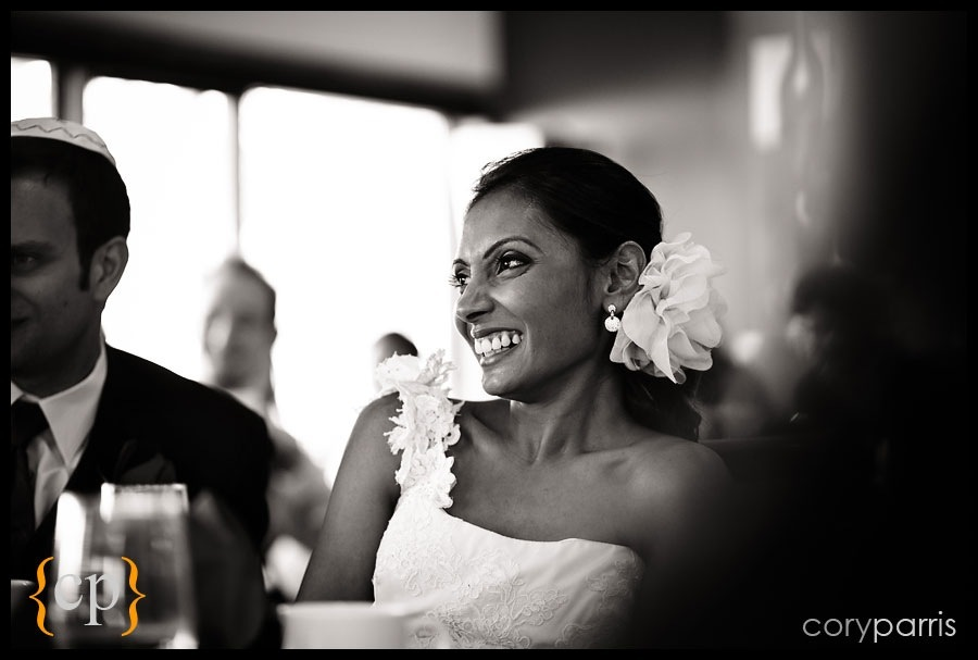 bride laughing during toasts by seattle wedding photojournalist cory parris