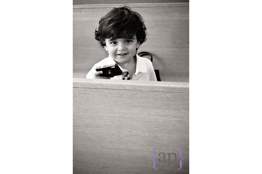 little boy in a church pew by seattle wedding photographer alyssa parris