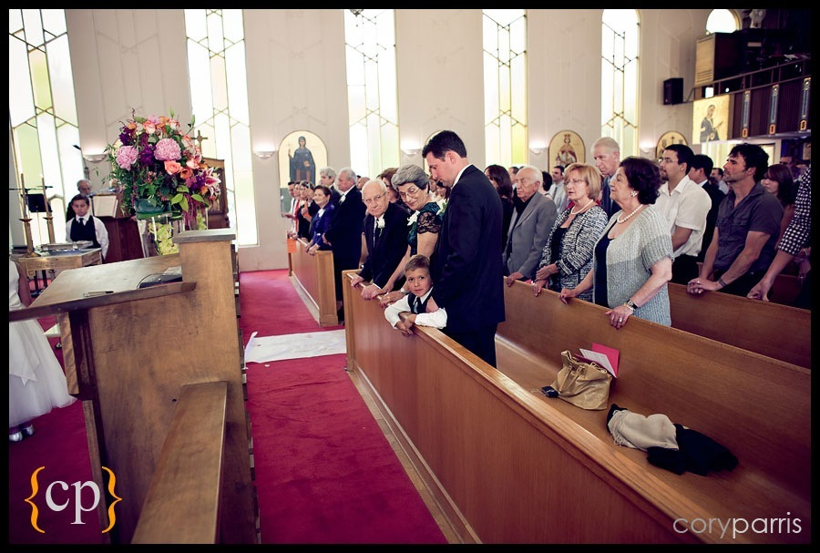 wedding guests at the greek orthodox church of the assumption by seattle wedding photographer cory parris