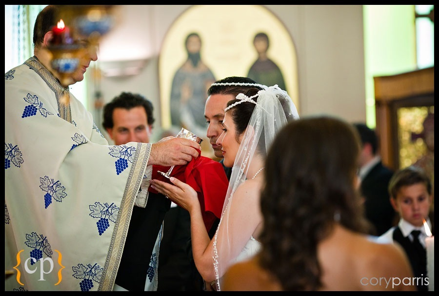 wedding couple sharing wine at a greek wedding in seattle