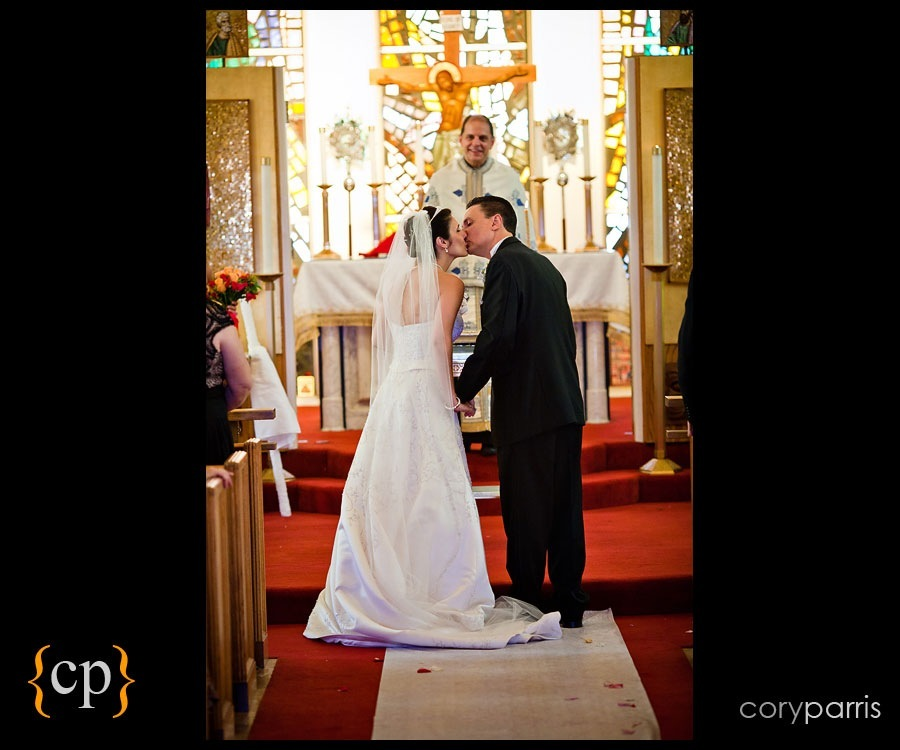 bride and groom kissing at wedding at the Greek orthodox church