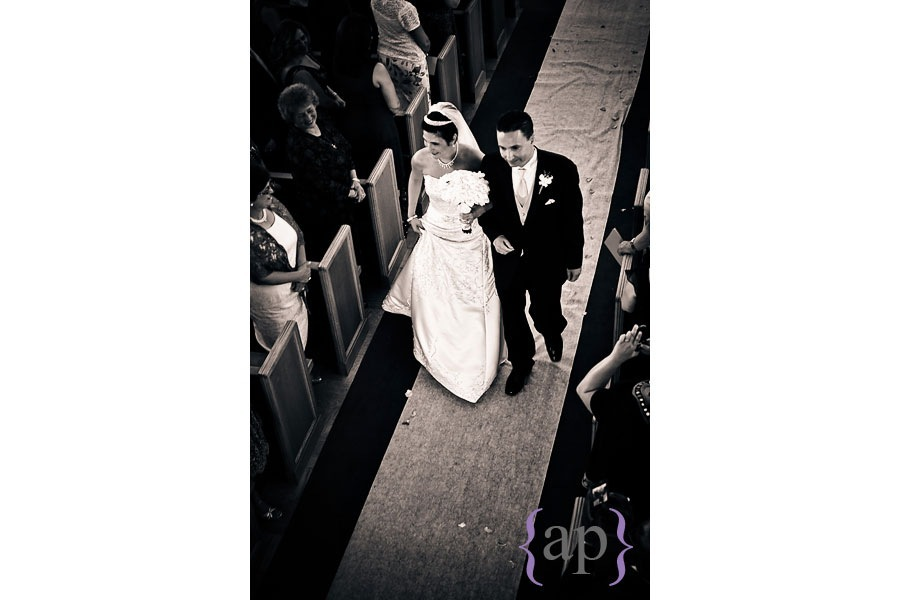 bride and groom coming back down the aisle at the greek orthodox church of the assumption by seattle wedding photojournalist alyssa parris