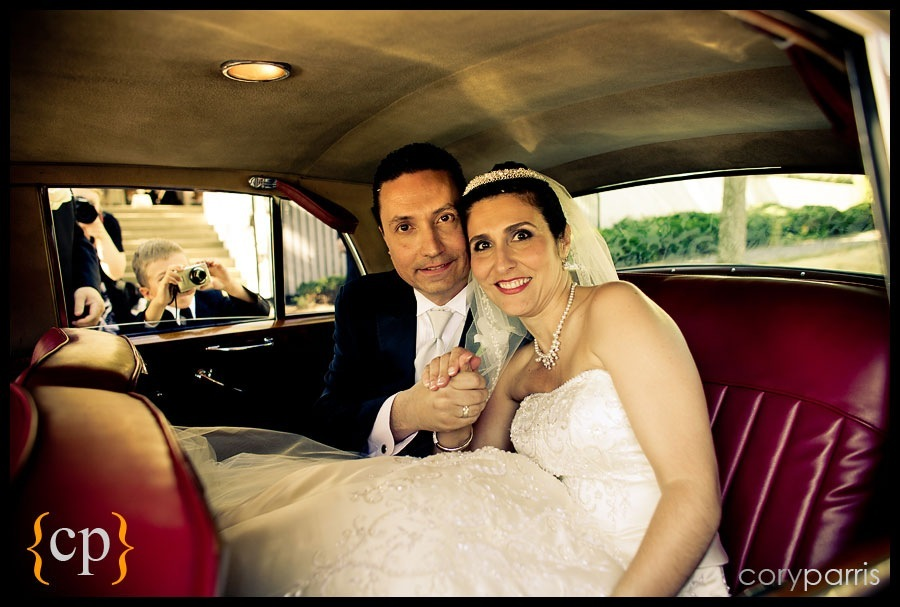 bride and groom in rolls by british motor coaches in seattle