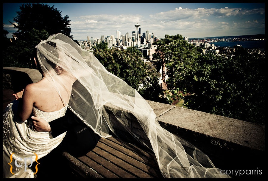 bride groom and veil with space needle in seattle