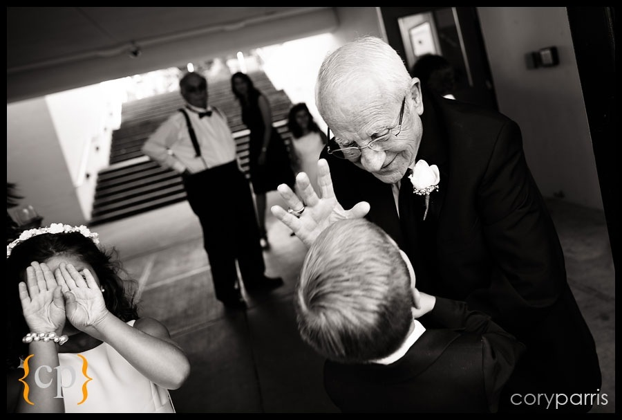 grandpa getting high five by seattle wedding photojournalist cory parris