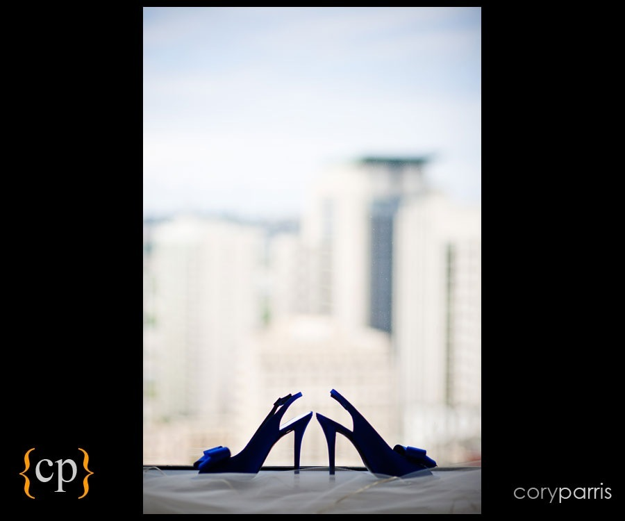 wedding shoes in the window with downtown seattle in the background by wedding photographer cory parris