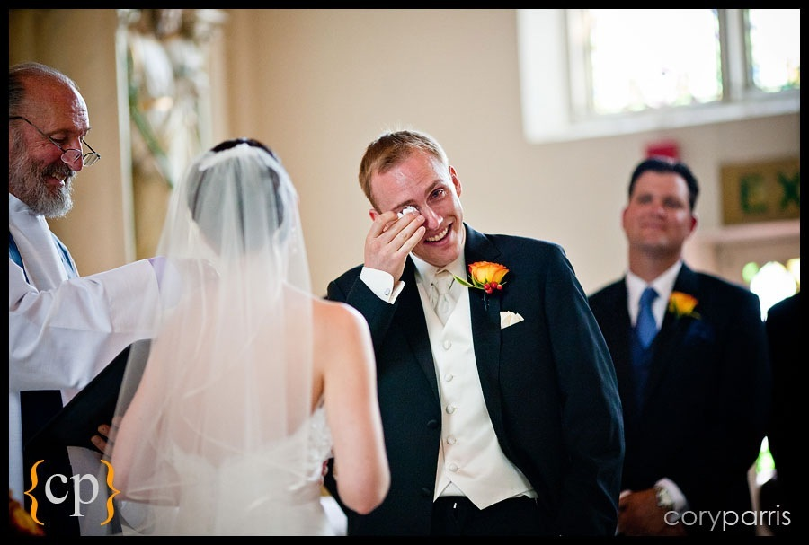 groom crying as he says his vows
