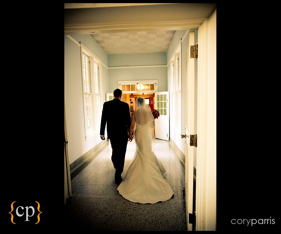 bride and groom walking away after the wedding by seattle wedding photographer cory parris