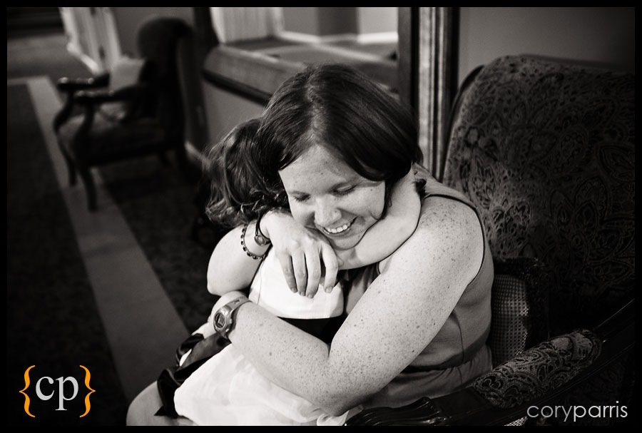 little girl hugging her mom at a wedding at sand point country club