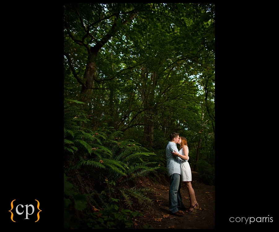 couple portrait in the woods with strobist by seattle photographer cory parris
