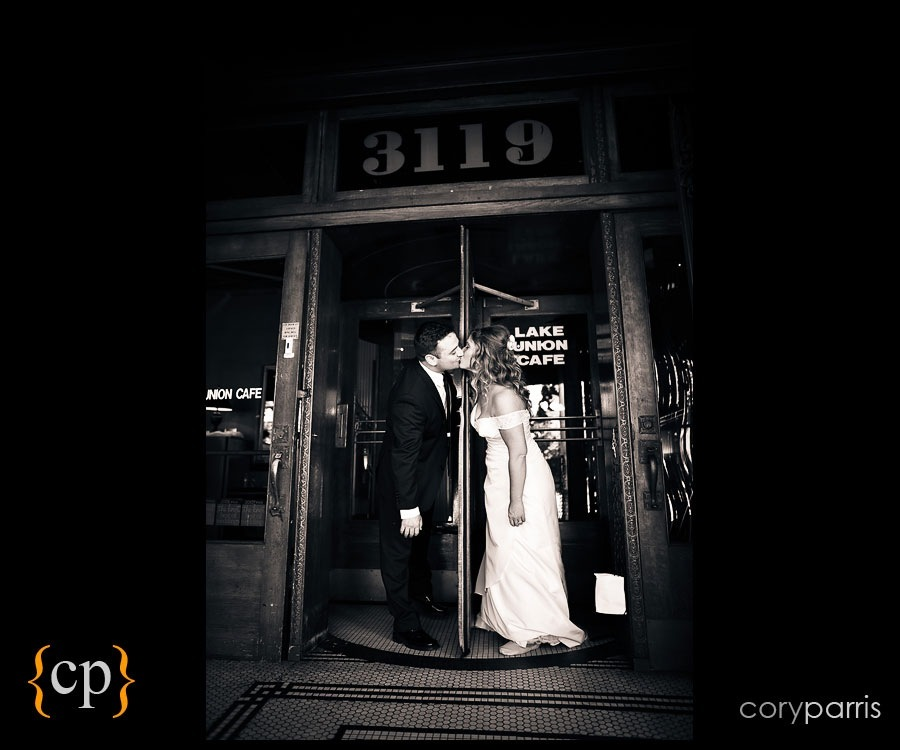 couple portrait in revolving door at lake union cafe by seattle wedding photographer cory parris