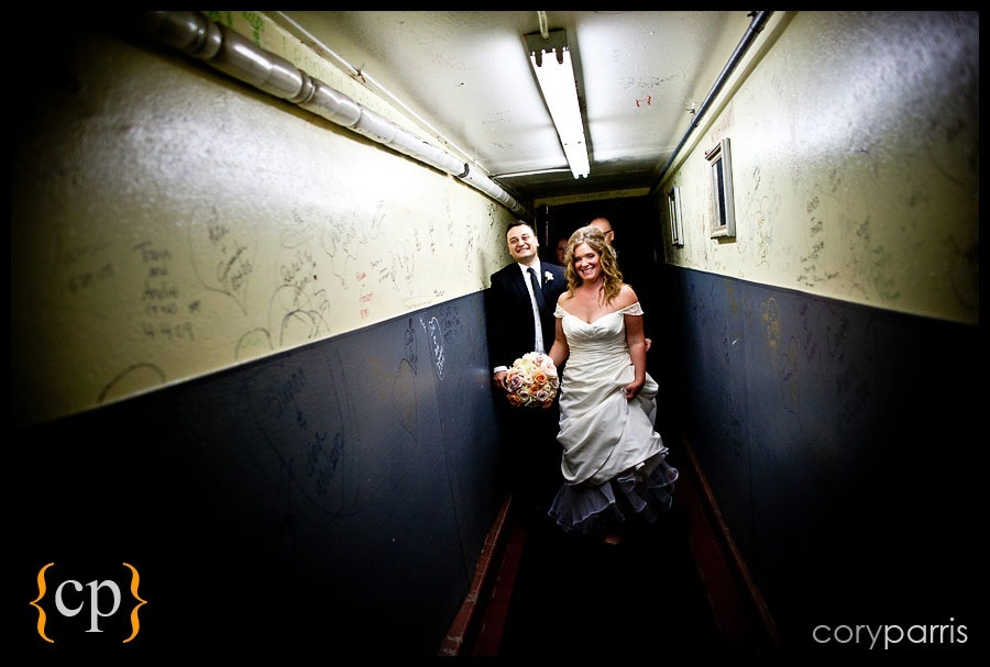 bride and groom walking through the hallway underneath the lake union cafe for their wedding