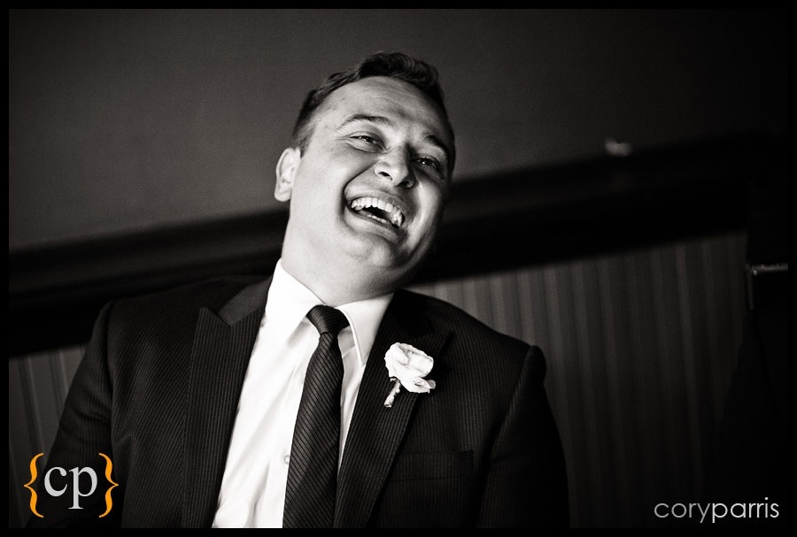 groom laughing at the lake union cafe wedding