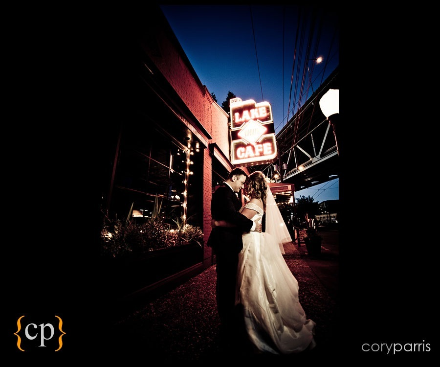 bride and groom portrait at the lake union cafe sign by seattle wedding photographer cory parris