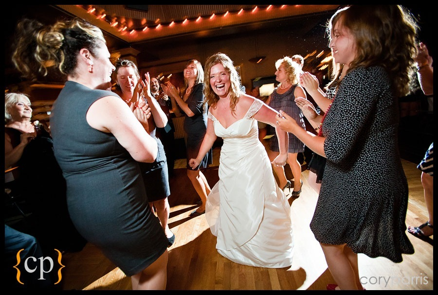 bride dancing at lake union cafe by seattle wedding photojournalist cory parris