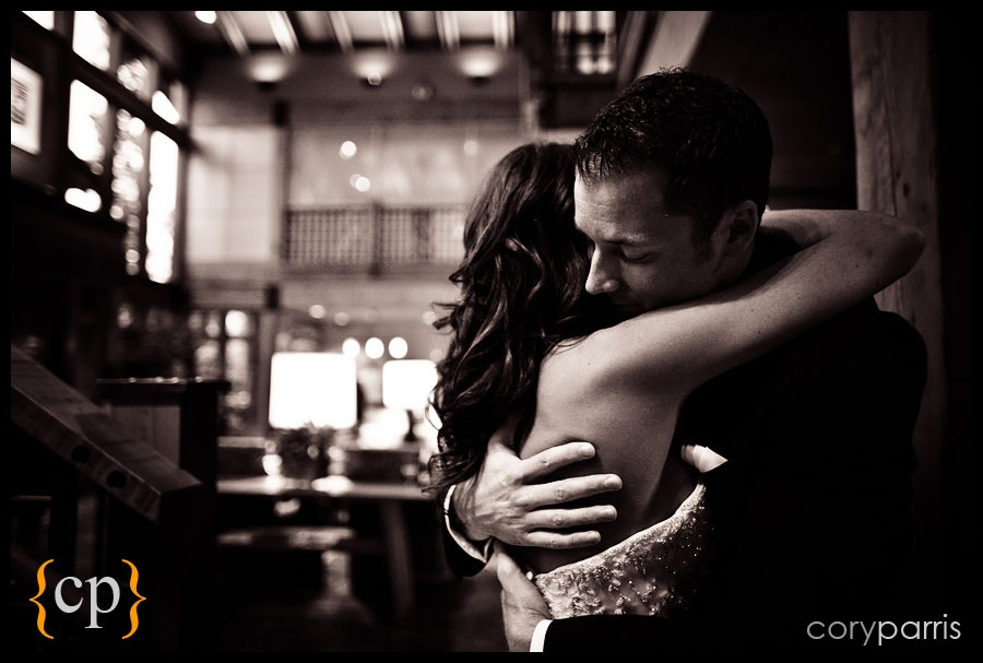 bride and groom hug at a wedding at willows lodge by seattle wedding photojournalist cory parris
