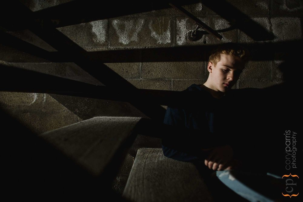 For one of his senior portraits, I took Tyler in to a parking garage stairway and set up a flash to create the lines of light and shadow.