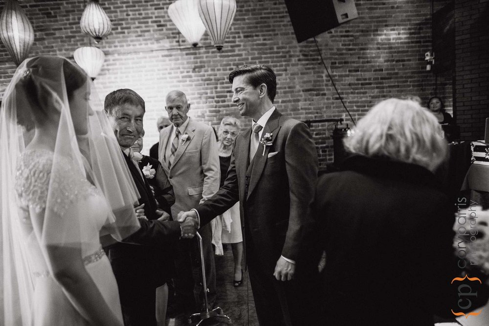 Greg shaking hands with Dianna's father.