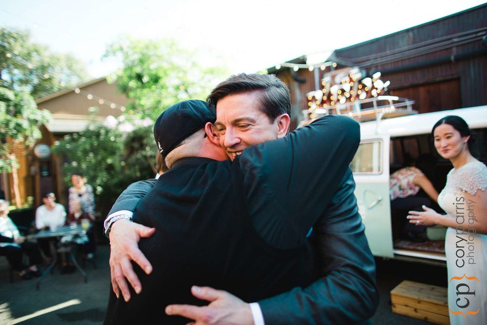 Greg hugging a guest.