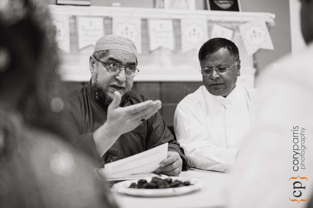 The Imam talking to the couple during the wedding ceremony.