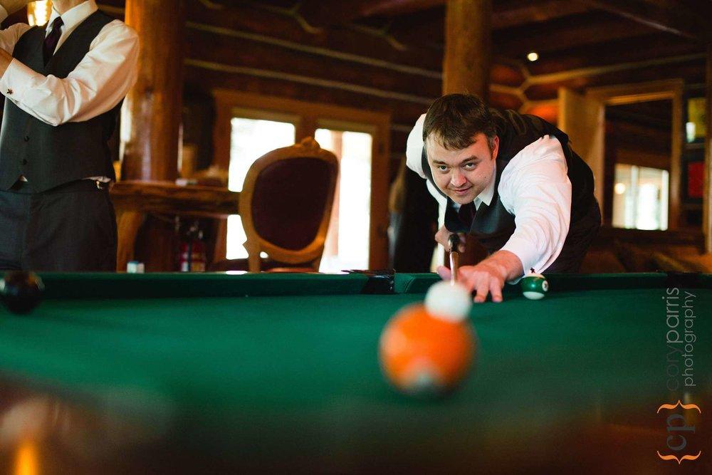 Groomsman playing pool
