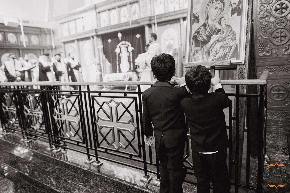 Little boys watching the wedding