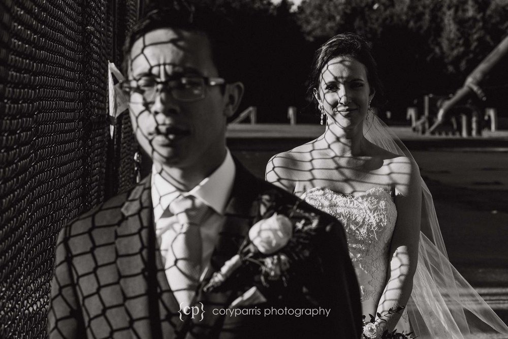 This one was interesting to me. I was playing with the pattern of light through the fence. I like the image, but it is a bit different for a wedding photograph.