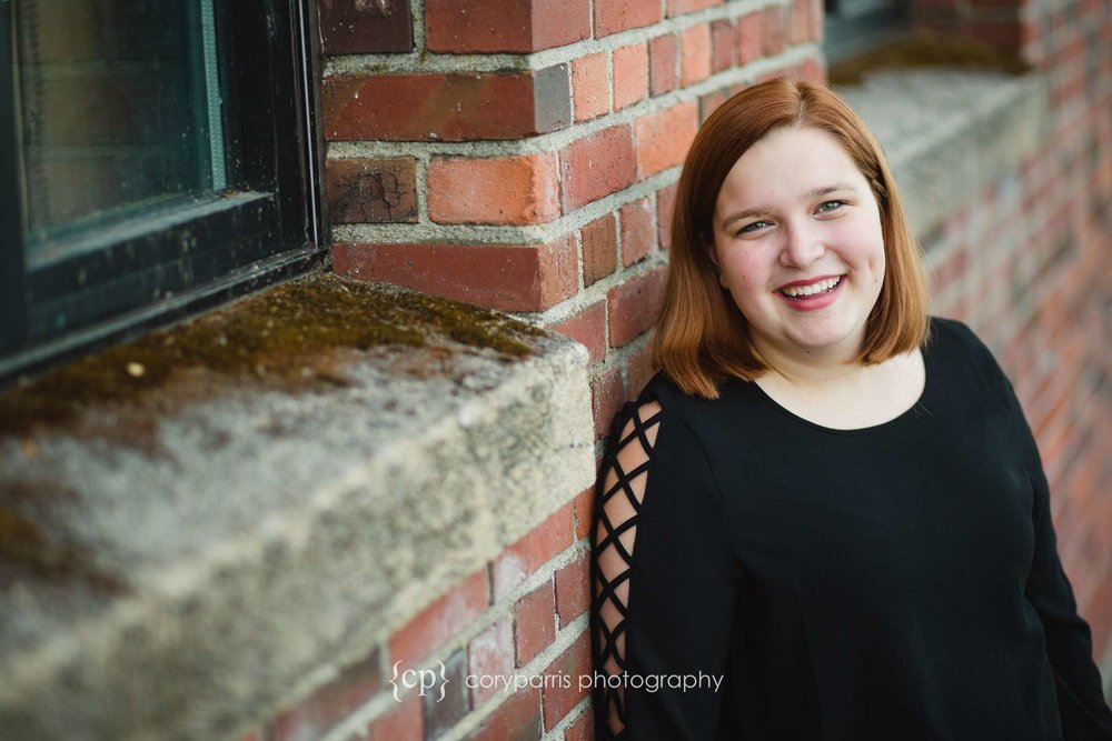 Senior portraits with brick wall background