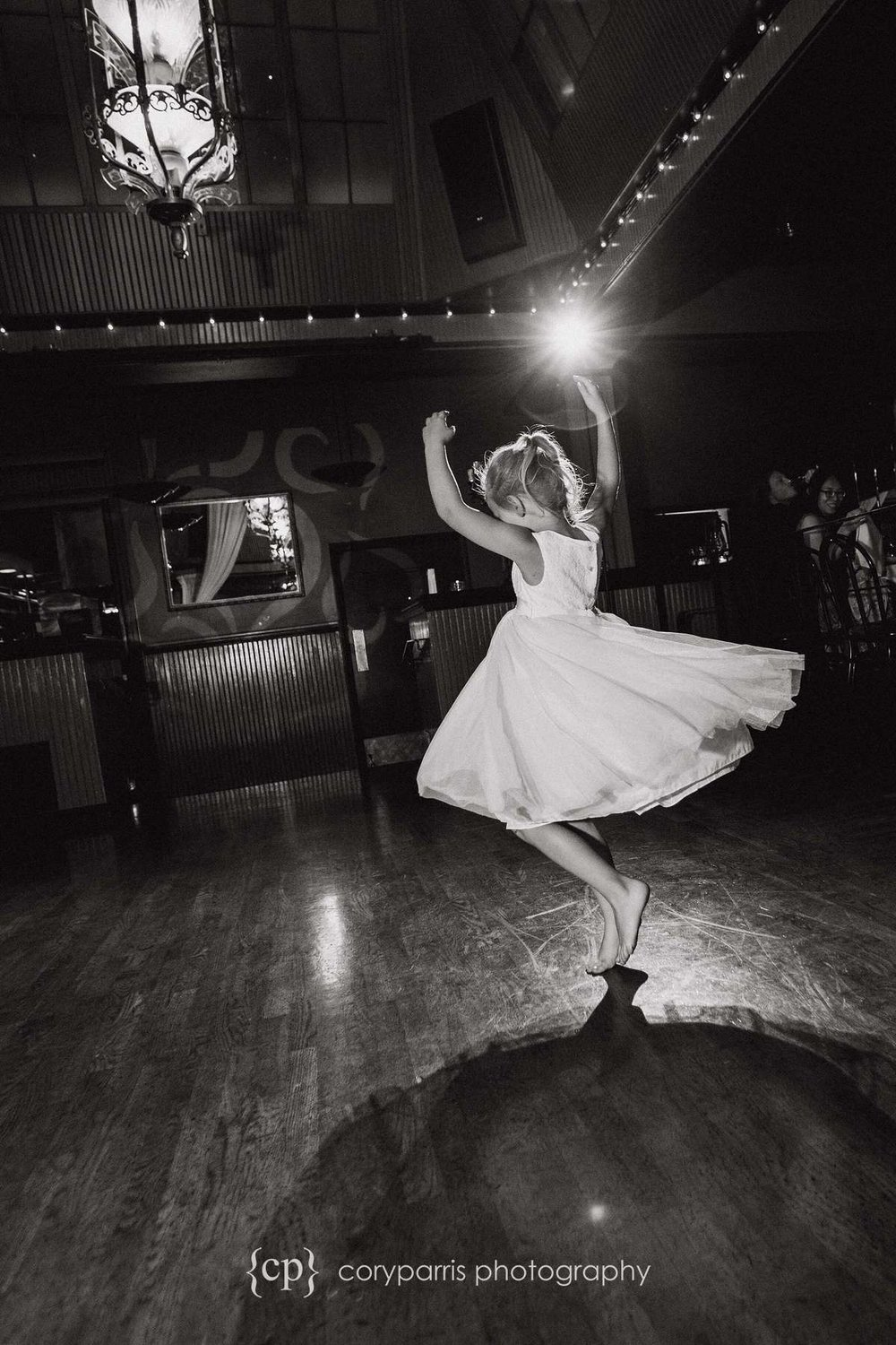 Little girl dancing at Lake Union Cafe wedding