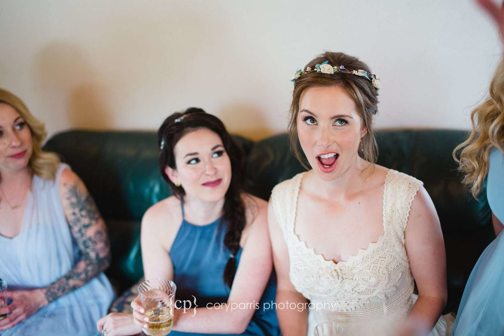 Bride being funny at a Woodinville wedding at DeLille Cellars Chateau