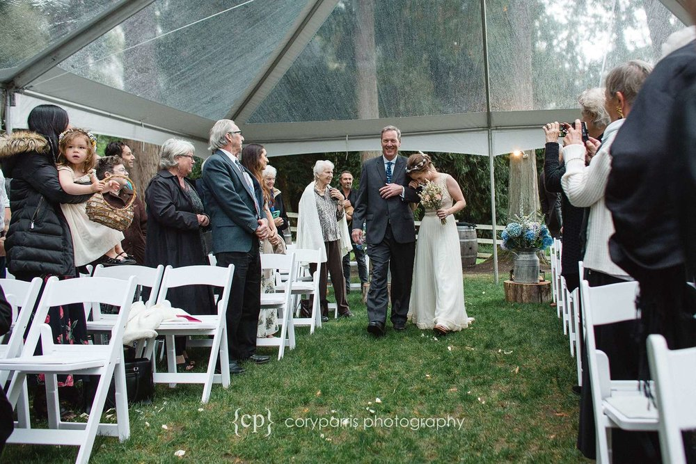 I love this image of Sonya putting her head on her dad's shoulder as they walk down the aisle before the wedding.