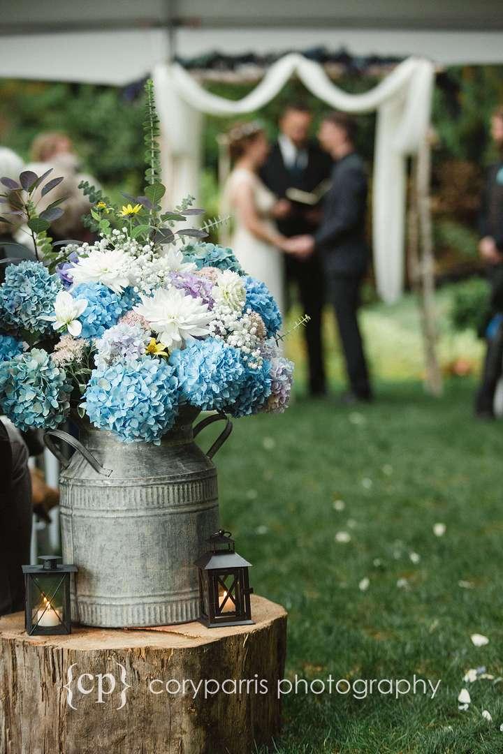 Tin milk jug and Hydrangeas wedding decor
