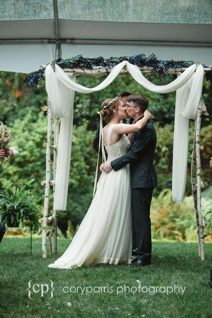 First kiss wedding ceremony at DeLille Cellars Chateau wedding
