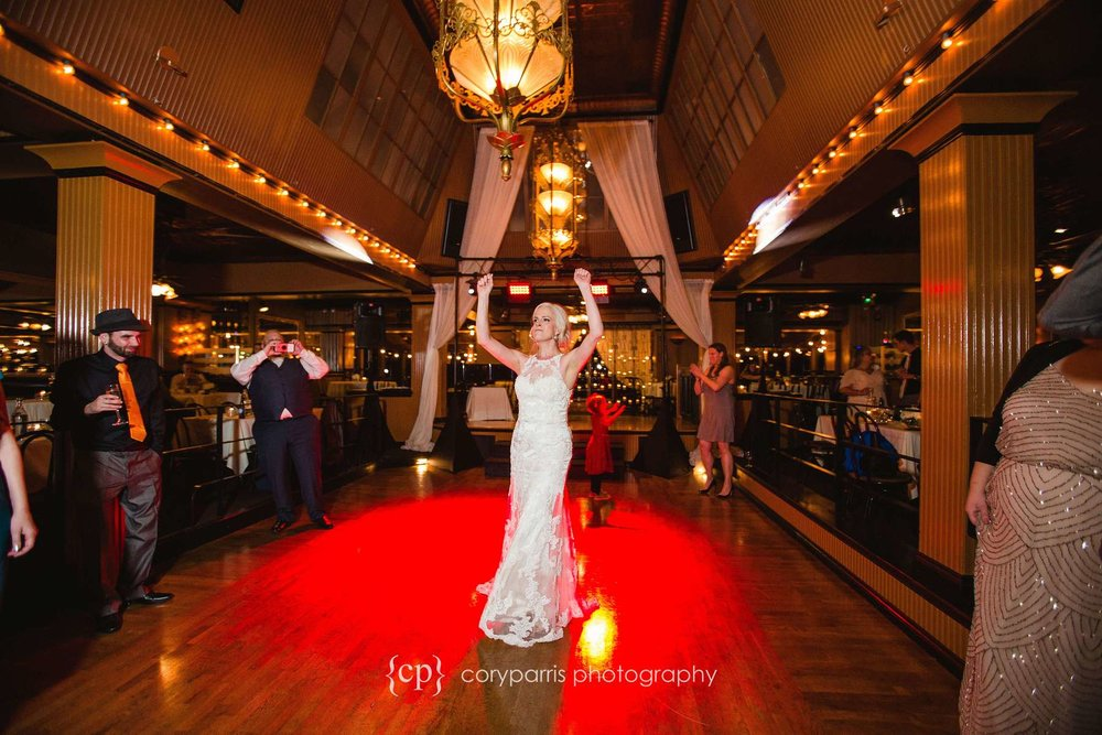 Bride dancing at Lake Union Cafe wedding reception