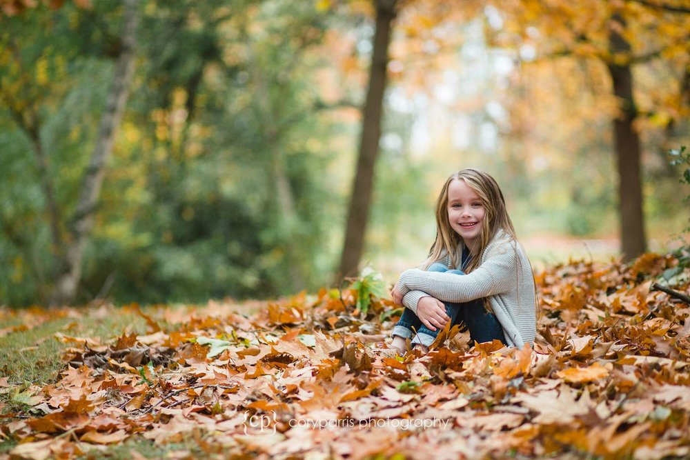 Girl in fall leaves Seattle portrait photographer